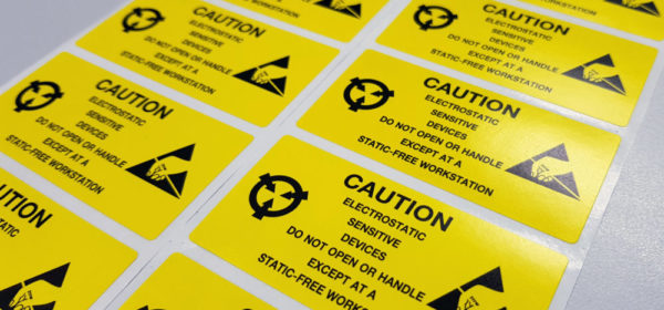 "Standard caution label with text ""Caution"" for Electrostatic Sensitive Devices (ESD) in electronic industrial."