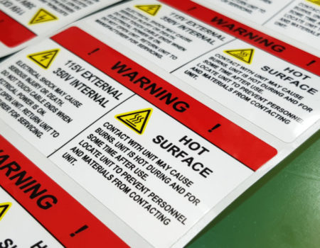 "Danger sign banner with warning text,""HOT SURFACE"" warning label in electronic industry"